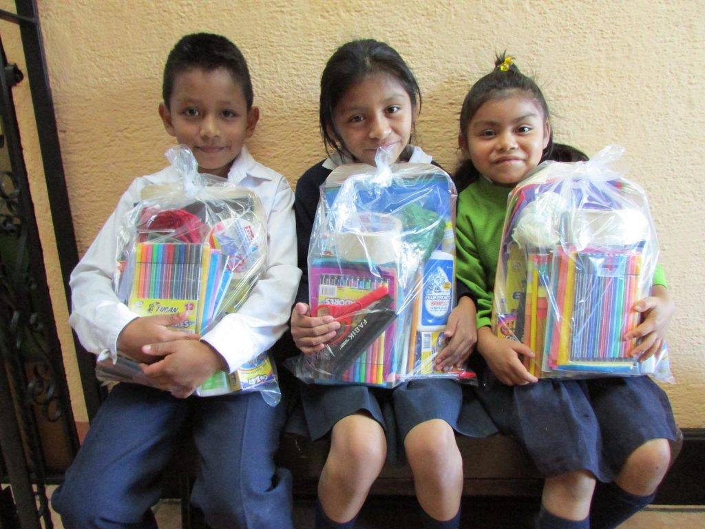 Happy School kids with supplies